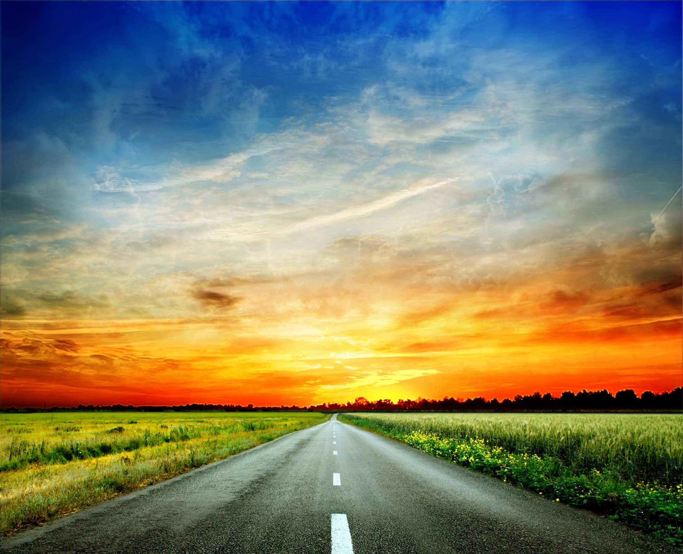 bigstock-Long-country-road-with-white-l-36393616 copy