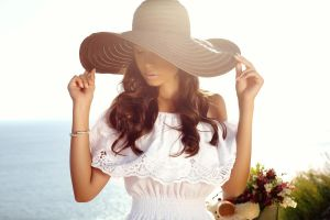 Beautiful Girl With Dark Hair In Elegant Dress And Hat
