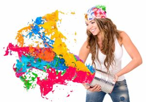 Woman splashing colorful paint from a can - isolated over white background